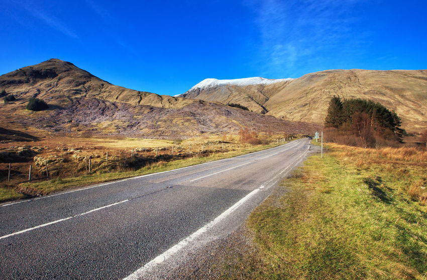 Endless Scottish road in Highlands, Scotland, UK Blue Day Endless Endless Road Landscape Landscape_Collection Mountain Mountain Range Mountain View Mountains No People Outdoors Picture Road Road Roadtrip Rural Scene Scenery Scenics Scotland Scottish Highlands Travel Trip Uk Winding Road
