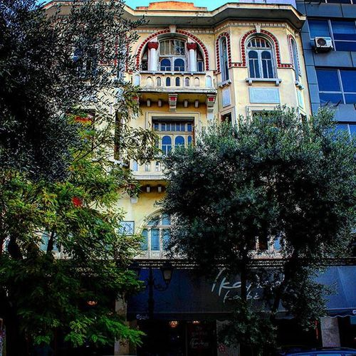 Vintage Building Architecture Old Renovation Beautiful Awesomebuilding Arches Balcony Windows Brick Concrete Marble Details Instalike Trees Green Colours White Terracotta Cream Orange Downtown City center Street photography Photography canon700d Thessaloniki Greece skg