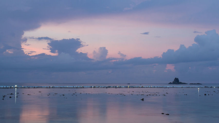 Lancing Beach filled with thousands of people collecting worms. Lombok Bau Nyale Festival, Indonesia Blue Hour Cloud Community Event INDONESIA Many People Bau Nyale Blue Culture Dawn Festival Long Exposure Ocean Shore Sunrise Togetherness Torches
