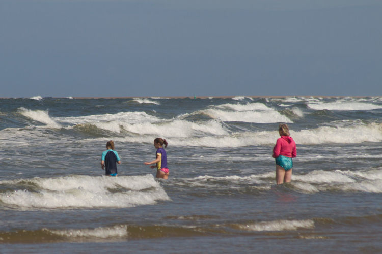 Fun in the Surf Beach Holiday In The Sea Leisure Activity Lifestyles Outdoors Paddling People Sand Sea Surf Water Wave Wave Jumping Waves