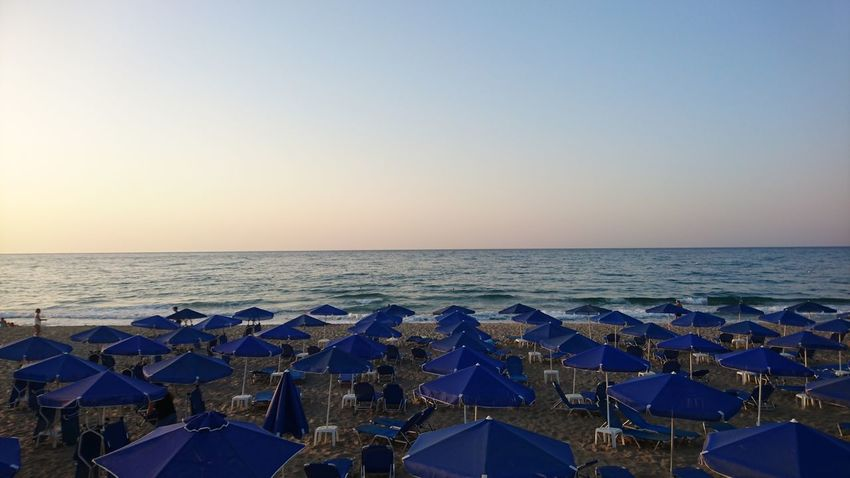 Sea Beach Horizon Over Water Canopy Outdoors Summer Blue Business Finance And Industry Tranquility No People Travel Destinations Clear Sky Vacations Sunset Water Day Sky City Nature Rethymnon Crete Rethymnon Mediterranean Sea Crete The Week On EyeEm