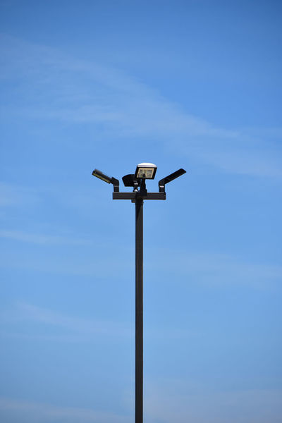 Parking Lot Lighting on Blue Sky Background Lighting Equipment Blue Clear Sky Day Energy Fixture Low Angle View Nature No People Outdoors Pole Secuity Sky Technology