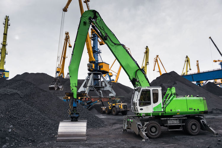 Work in port coal transshipment terminal. Boats Business Cargo Coal Container Cranes Cranespotting Dock Export Harbor Import Industry Logistic Metal Mine Mineral Portrait Scrap Sea Ship Shipping  Steel Storage Terminal Transportation