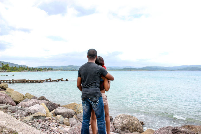 Looking Out. Beauty In Nature Calm Cloud Countryside Couple Happy Couple Leisure Activity Lifestyles Love Nature Outdoors Peaceful View Rear View Rocks And Water Scenics Sea Shoreline Sky Standing Tranquil Scene Tranquility Vacations Viewpoint Water