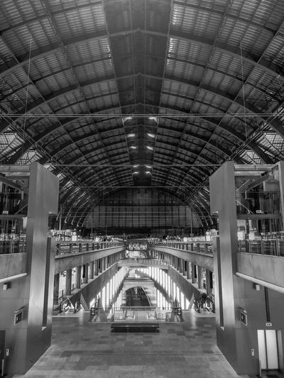 Antwerp, Belgium - Anno 2019: The train is waiting at the platform for passengers Inside the beautiful, historic and monumental Antwerp Train Station. Antwerp Central is often considered to be one of the most beautiful railway stations in the world. Architecture Built Structure Arch Indoors  Transportation Ceiling No People Illuminated Mode Of Transportation Rail Transportation Day Bridge Empty Connection Lighting Equipment Public Transportation Subway Station Bridge - Man Made Structure Direction Arched