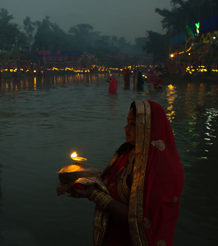 Reflection Night Tradition Cultures One Woman Only River Celebration Festival Spirituality Adults Only People Outdoors Oil Lamp Water One Person Adult Nepal Nepal Travel Nepali Festival Festive Lights Color Of Life Color Of Festivals Close-up Enirmal Day EyeEmNewHere Uniqueness The Street Photographer - 2017 EyeEm Awards The Photojournalist - 2017 EyeEm Awards The Portraitist - 2017 EyeEm Awards