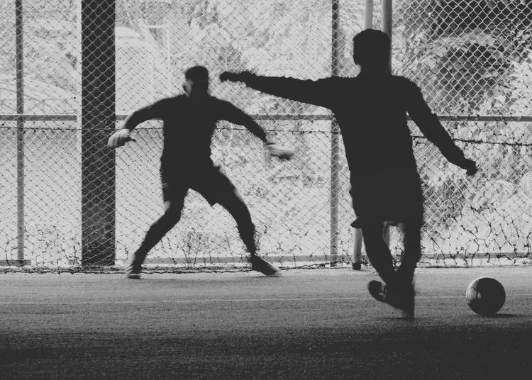 Friends playing soccer at park