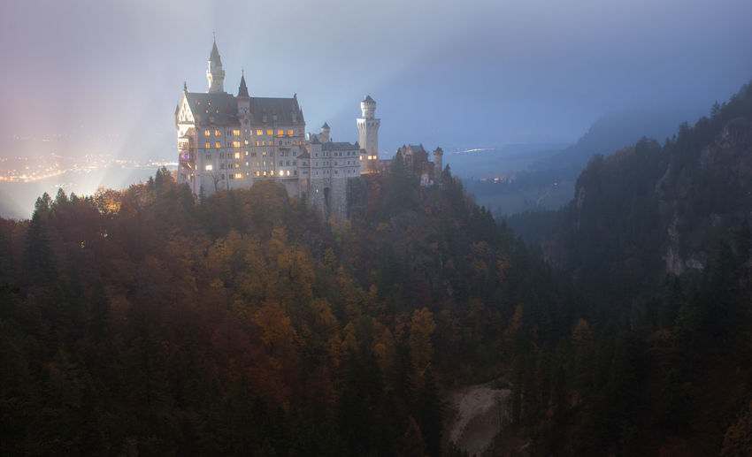 Neuschwanstein Castle with Autumn colors, Fussen, German Tree Building Exterior Built Structure Architecture Plant Nature Sky Building No People Outdoors Growth Fog History Tower The Past Religion Place Of Worship Travel Destinations Autumn Belief Change Skyscraper