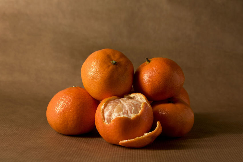 A pile of clementines on brown paper, with one half-peeled Citrus  Freshness Minimalist Brown Brown Paper Citrus Fruit Clementine Clementines Foodphotography Fruit Healthy Healthy Eating Healthy Food Ingredient Mandarins Minimal Minimalism Monochromatic Monochrome Mood Obst Orange Color Peel Peeling Pile Still Life