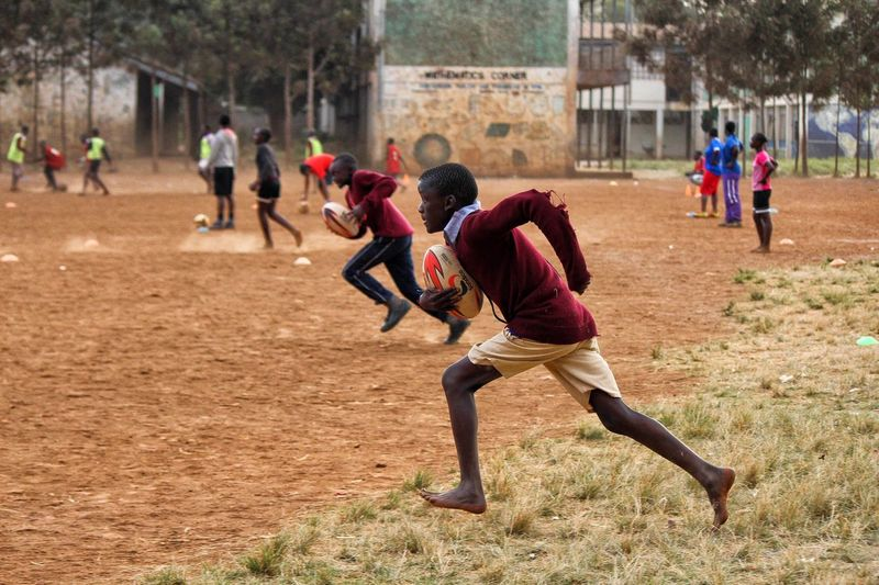 Hassan in action. Rugby Playing Eyeemphoto Children Portraits The Portraitist - 2016 EyeEm Awards Kibera Africa Nairobi Color Photography Enjoying Life EyeEm Best Shots Eyeemphotography EyeEm Gallery Freedom Canonphotography Kenya Sport Sports Photography Speed Need For Speed