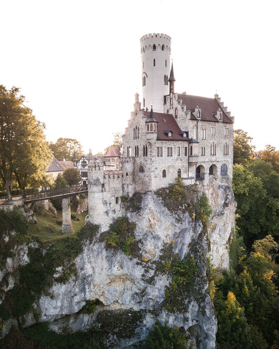 This one is from my last mission in Southern Germany: Castle Lichtenstein dancing in the sunset. The way this castle was build on a small cliff really amazed me! Autumn Castle Drone  Schloss Lichtenstein Architecture Building Exterior Built Structure Castle Clear Sky Cliff Day History Lichtenstein Low Angle View Nature No People Outdoors Sky Sunset Tourism Travel Travel Destinations Tree Water Waterfall