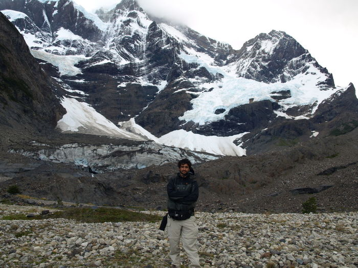 Man Standing Against Snowcapped Mountains At Torres Del Paine National Park