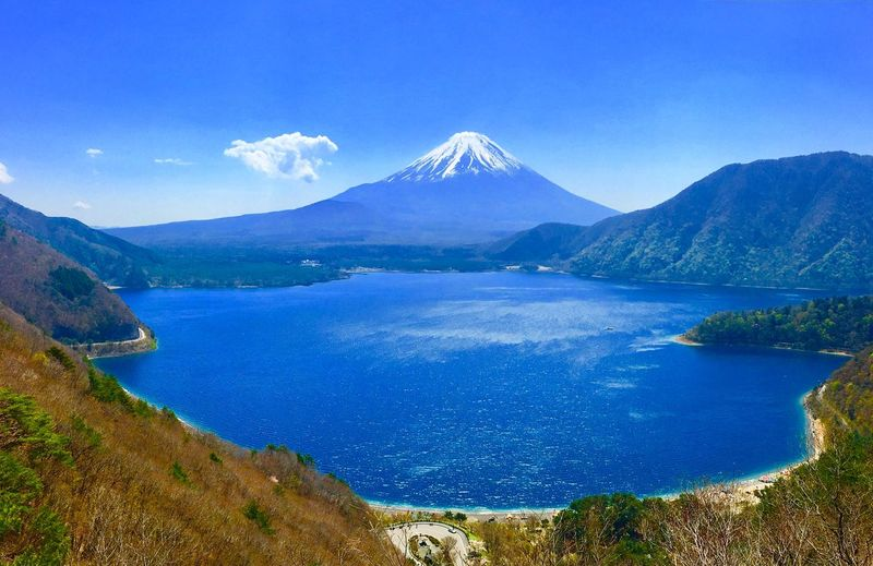 Mt. FUJI - Mountain Water Scenics - Nature Beauty In Nature Tranquil Scene Sky Tranquility Blue Cloud - Sky Non-urban Scene Nature Idyllic No People Lake Volcano Mountain Range Land Plant Environment Outdoors Mountain Peak Volcanic Crater