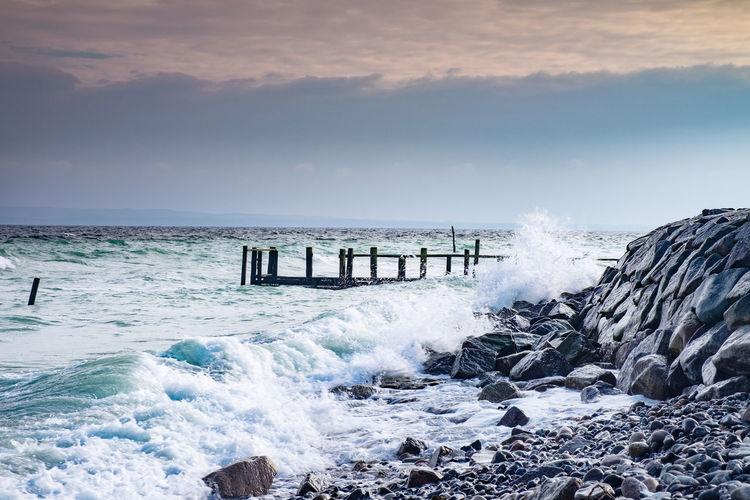 The wild storm damaged port pier at old fishing village vitt. the baltic sea coast, ruegen, germany
