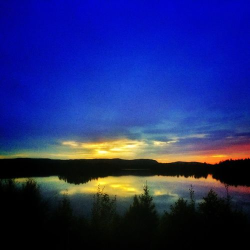 Sunset at the end of the world Tranquil Scene Scenics Lake Tranquility Blue Sunset Water Beauty In Nature Silhouette Sky Awe Tourism Idyllic Reflection Majestic Nature Calm Dramatic Sky Travel Destinations Non-urban Scene