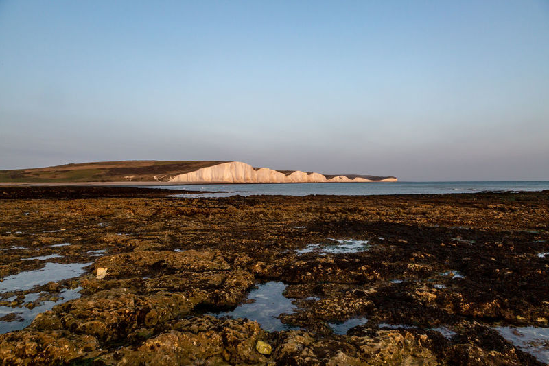 A view of the seven sisters cliffs at low tide, from hope gap beach on the sussex coast