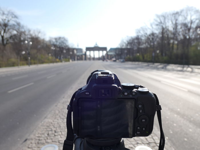 Rear view of camera on road against sky