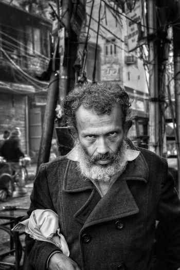 Portrait of mature man in city