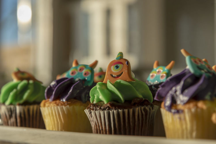Low angle close-up view of halloween cupcakes candy cakes