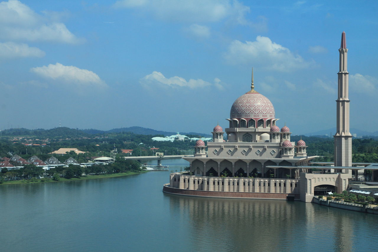 Mosque By River Against Sky