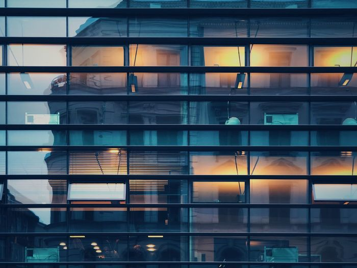 Full frame shot of office building with reflection