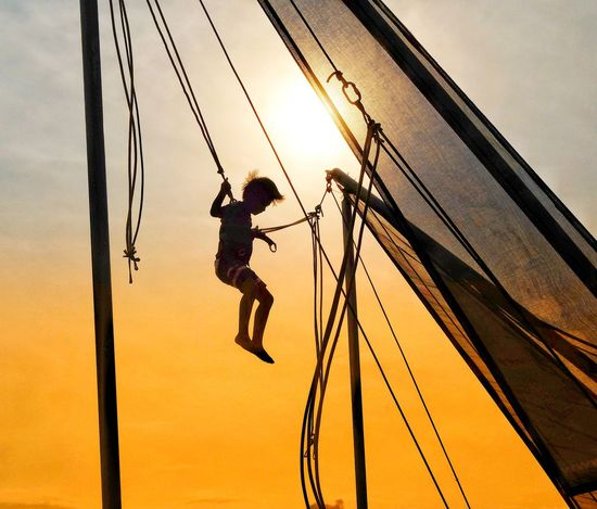 EyeEmNewHere Rope Sky Sunset Outdoors Day People Boy Slingshot Golden Hour Sunny Goldensunset Advanture Beach Hanging Enjoying Life Happiness Thrill Fun Amusement  Amusement Park RISK Swing First Eyeem Photo The Great Outdoors - 2018 EyeEm Awards