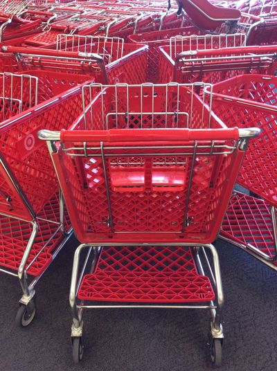 Red Target Shopping Trolleys Carts plastic Wheels Supermarket Consumerism Retail  Empty Metal No People Indoors  Store Repetitive Pattern of trolleys Stored Together Bunched Together March 2017 IPad Mini EyeEm Best Shots I Pad Photography I Pad Mini Phoenix, AZ USA A Pack Of Trolleys