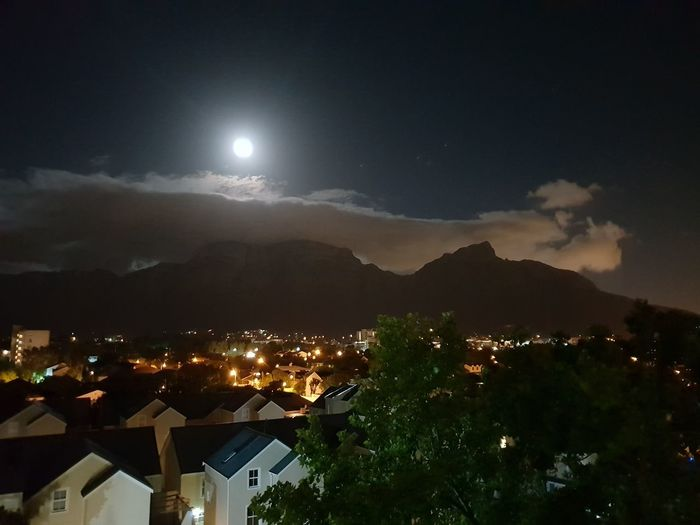 Full Moon over Table Mountain Cloud - Table Cloth Over Mountain Illuminated Mountain Moon Cityscape Moonlight Sky Full Moon Mountain Range Tranquil Scene