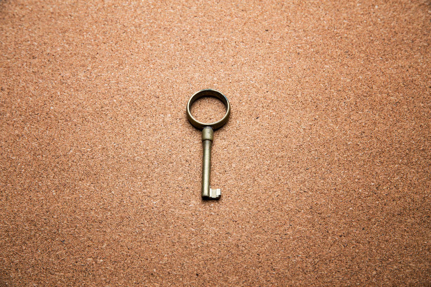 Close up view of a vintage key - Studio shot Antique Backgrounds Brown Circle Close-up Day Directly Above Geometric Shape High Angle View Land Metal Nature No People Outdoors Rough Rusty Sand Shape Single Object Textured  Textured Effect