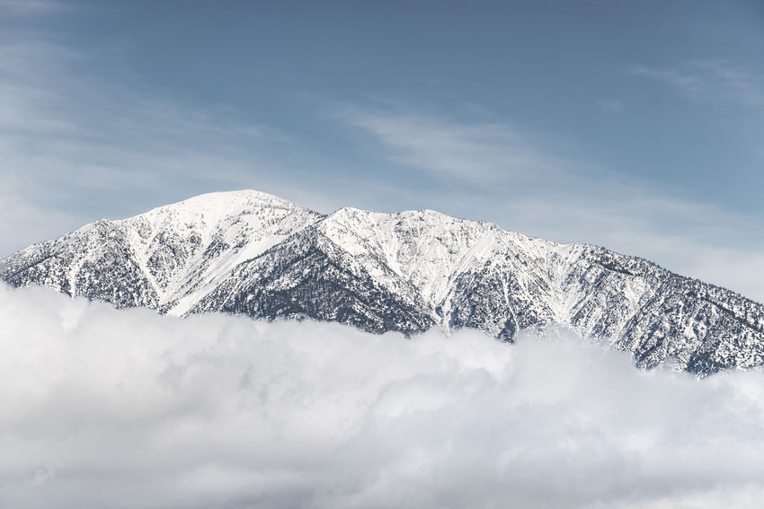 Elevated. Blue Sky Sky Mountain Ranges Clouds Snow Landscape Mountain