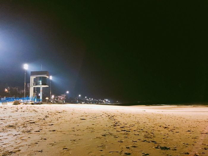 Night Sand Illuminated Beach No People Outdoors Nature Sky Oil Pump Film
