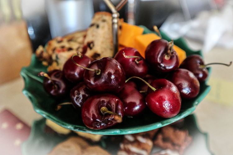 Close-up of cherries in plate on table