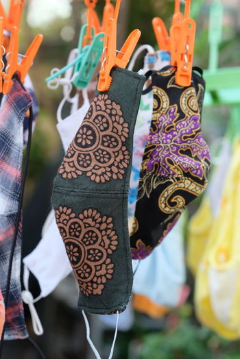 Low section of clothes hanging at market stall