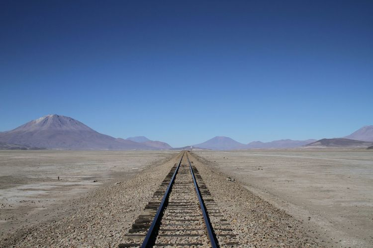 Railroad Track Leading Towards Mountain