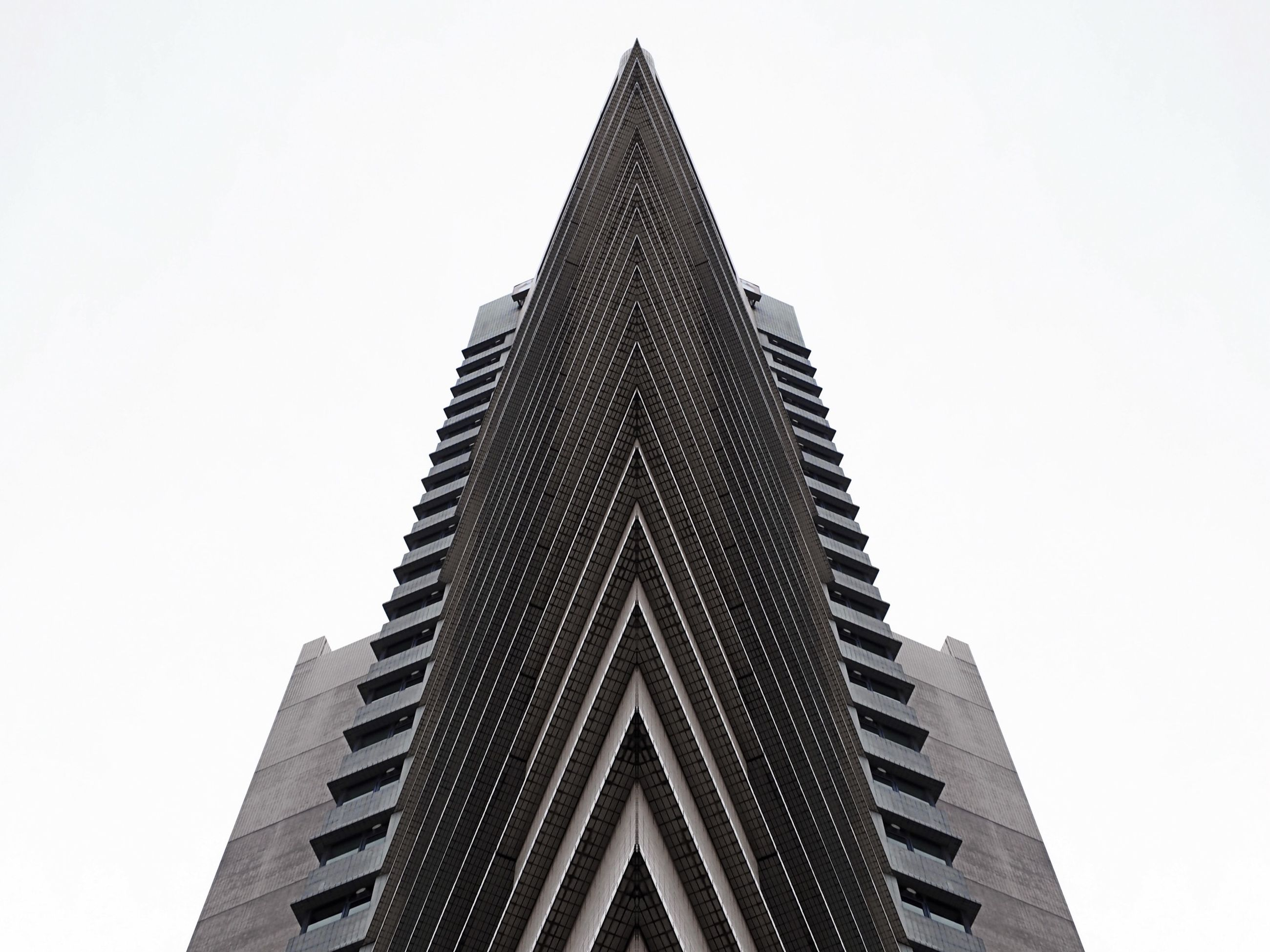 architecture, building exterior, low angle view, built structure, clear sky, tall - high, tower, skyscraper, city, modern, copy space, building, office building, tall, sky, day, outdoors, no people, high section, directly below
