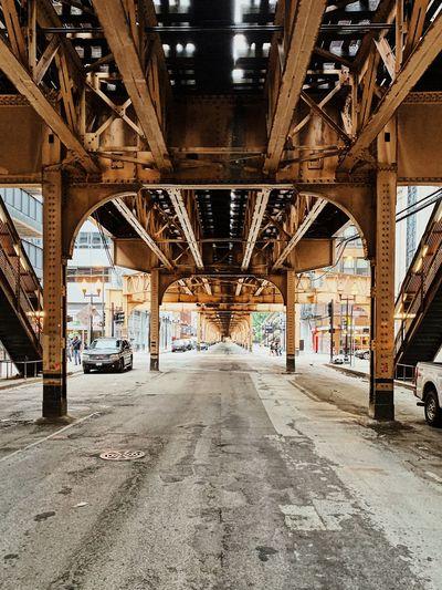 Underneath view of bridge in city