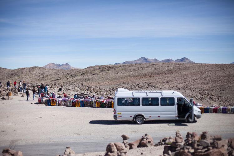 Tour Bus At Desert Market Against Sky