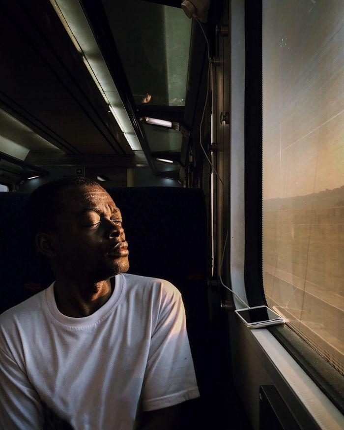MAN LOOKING AT TRAIN