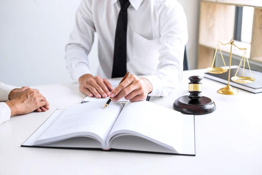 Lawyer Activity Balance Barrister Book Education Fairness Gavel Hand Holding Human Hand Indoors  Judge Judgement Justice Legal Legislation Men Occupation Paper Pen Publication Studying Verdict Writing
