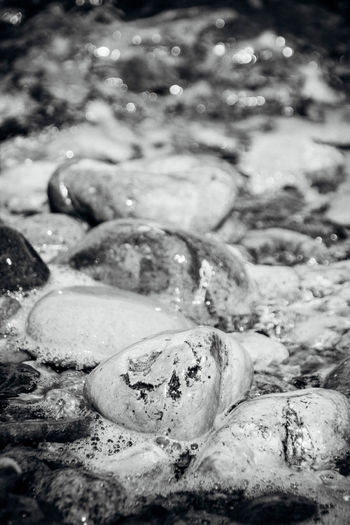 At Ground Level No People Non-urban Scene Pebbles Pebbles And Stones Pebbles And Water Rushing Water Sea Selective Focus Shore Tidal Tide Water Water Surface Waterfront