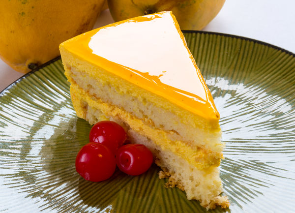 Mango cake slice garnished with red cherries. Indulgence dessert with natural flavor Close-up Day Daytime Dessert Flavor Food Fresh Freshness Freshness Indulgence Lighter Mango Mango Cake Mango Flavor Natural Natural Light Natural Lightning No People Still Life Sweet Food Tropical Flavor Yellow