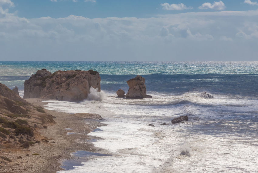 View of Aprhrodite's rock in Cyprus on a stormy day. Seascape Coastline Beach Tourism Aphrodite's Rock Rock Landmark Outdoor Famous Cyprus Visit View Beach Beauty In Nature Cloud - Sky Day Horizon Over Water Nature No People Outdoors Relaxing Rock - Object Scenics Sea Sky Storm Vacations Water Wave