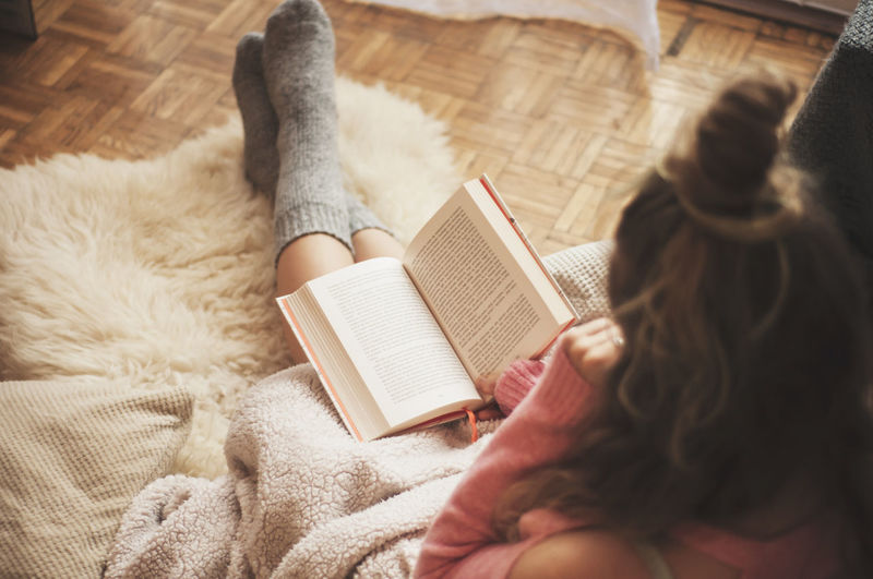 Coziness at home, girl hygge with blanket, book and coffee Alone Coffee Home Morning Sunny Weekend Woman Blanket Book Coziness Cozy Female Girl Hazy  Hygge Lifestyles Pastel Pastel Colors Read A Book Relax Resting Solitude Vintage Warm Warm Clothing