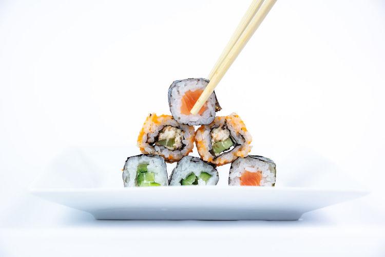 Close-up of sushi against white background
