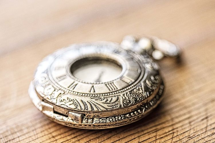 Silver Pocket watch Still Life Close-up Indoors  No People Selective Focus Single Object Wood - Material Table Focus On Foreground Wealth Metal Antique High Angle View Two Objects Pattern Finance Silver Colored Studio Shot Design Jewelry Luxury Personal Accessory