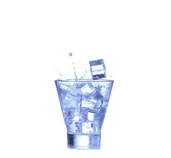 Close-up of glass over white background