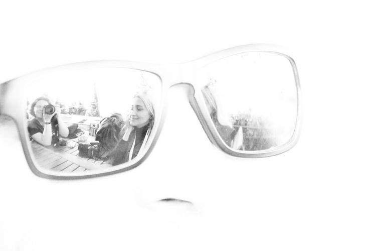 Reflection of sunglasses on mirror