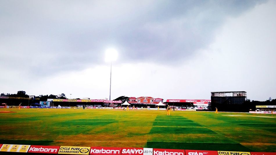Karnataka Primere League @KSCA_STADIUM Hubli Grass Field Landscape Sky Architecture Green Color Building Exterior Group Of People Day Playing Field Cloud Grassy Outdoors Cloud - Sky Green Residential District Tranquility First Eyeem Photo