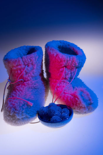 Colourful Subjects Boots Colourful Sheep Wool Winter Blue Close-up Cold Colorful Freshness High Angle View House Shoes Illuminated Indoors  No People Still Life Studio Photography Studio Shot
