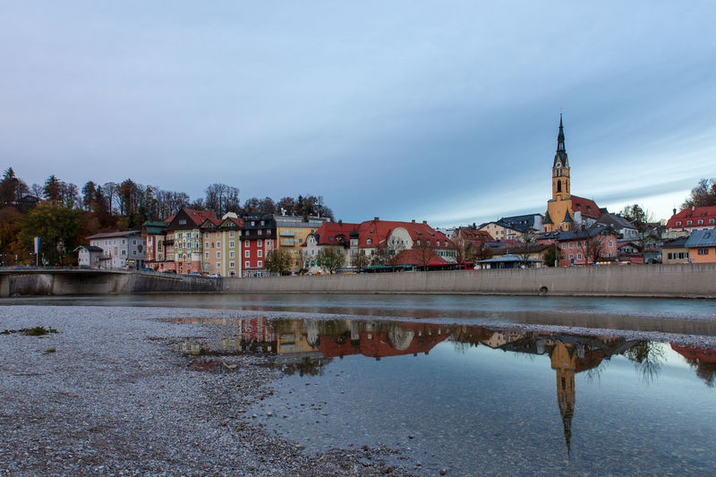 Cityscape Bad Tölz, Bavaria, Germany Bad Tölz Bavaria Germany River Isar Isar Isar River Architecture Building Exterior Built Structure Water Sky Building Religion Belief Place Of Worship City Spirituality Nature Reflection Waterfront River Tower No People Outdoors Spire
